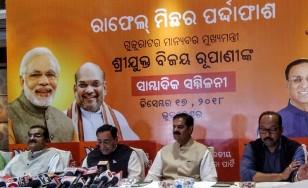 Rafale deal: Gujarat CM attacks Rahul, Odisha Congress puts Modi in dock